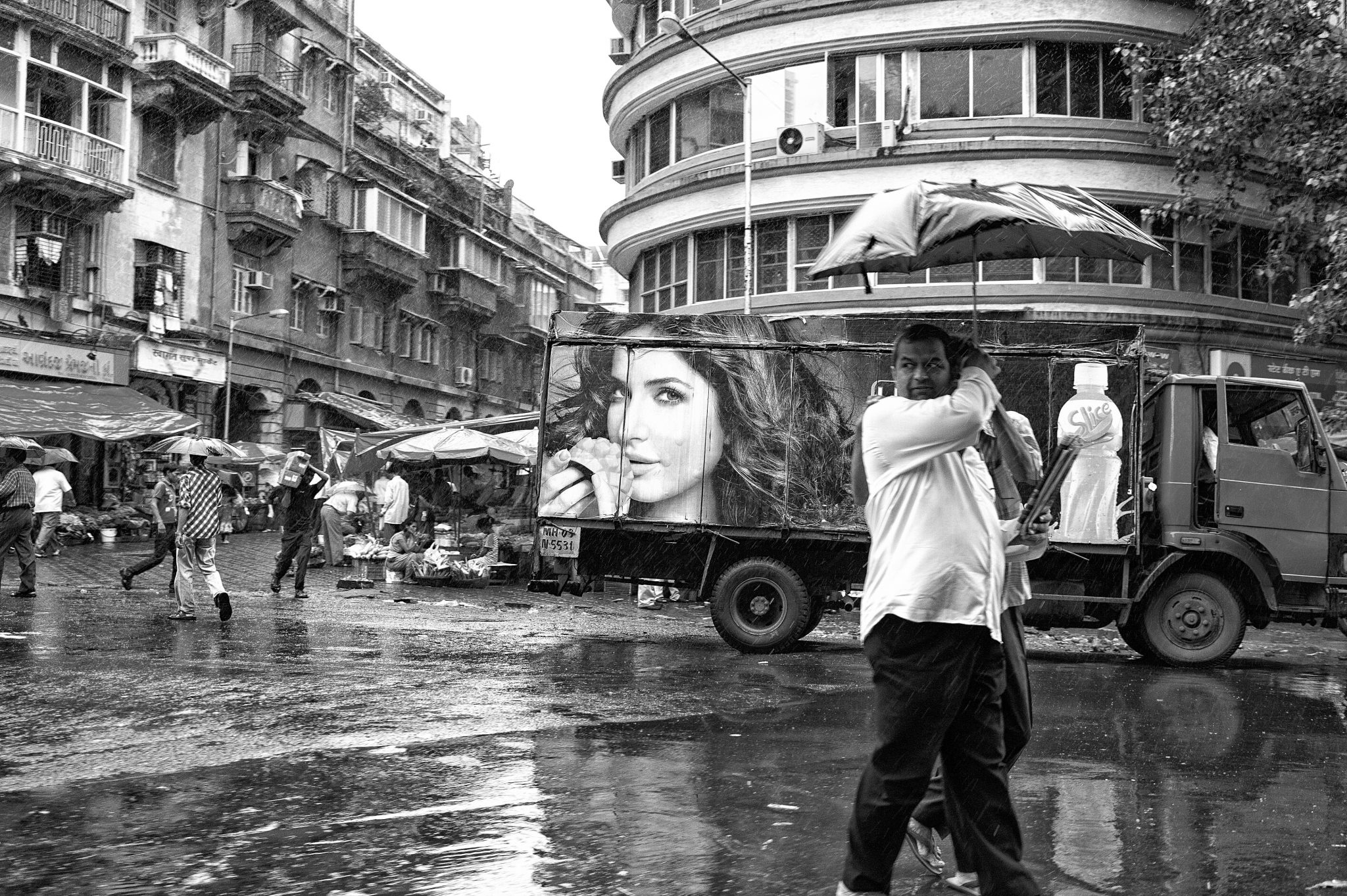 street photography of man in mumbai caught in a storm